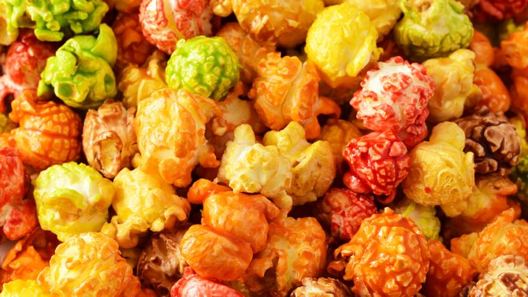 Popcorn multicolored. Air salty popcorn on the table